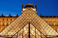 Glass pyramid and ancient architecture of Musee du Louvre, Paris France.