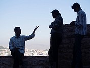 Silhouette of friends talking at fort in Jodhpur, Rajasthan, India.