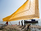 Sari being dried in front of a river in Varanasi, Uttar Pradesh, India.