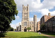 Ely Cathedral, Cambridgeshire, England. Over Palace Green to the West Tower and the West Door.