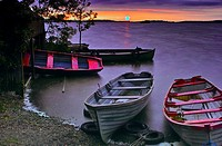 Sunset over Lough Owel, with moored boats in the foreground, near Mullingar, County Westmeath, Ireland