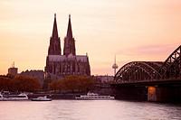 Cologne Cathedral with River Rhine and Hohenzollern Brucke (Bridge), Cologne, Rhine-Westphalia, Germany.