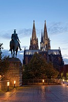 Cologne Cathedral with statue of member of Hohenzollern family, Cologne, Rhine-Westphalia, Germany.