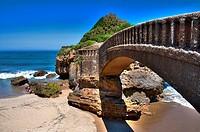 Arch bridge on the beach, Basque Coast, Biarritz, Aquitaine, Basque Country, Pyrenees Atlantiques, 64, France.