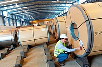 Rolls of sheet steel for the automotive industry, Siderurgical products, Port warehouse, Pasajes Port, Gipuzkoa, Basque Country, Spain.