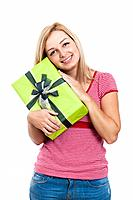 Young happy woman holding present, isolated on white background.