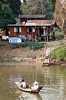 Boat, dock, river and shack in the city of Phra Nakhon Si Ayutthaya, Thailand.