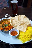 Wetherspoon curry club vegetarian Indian style meal with rice papadams and chutney Glasgow Scotland Britain UK Europe.