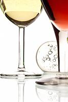 Detail of a glass of red wine and a glass of white wine.