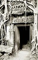 Doorway in Ta Prohm. The Temples of Angkor in Siem Reap in Cambodia in Southeast Asia Far East.