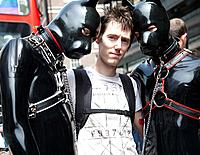 London Gay Pride - Characters dressed in Slave Dog Gimp on the March.