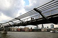 Millennium Bridge over River Thames with north bank of River Thames in the background, London, England, UK
