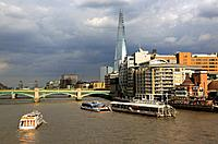 A tour boat in River Thames with the Shard the tallest building in the European Union in the background, London, England, UK
