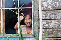Little Girl behind a Window Glass in Banjarmasin, Indonesia.