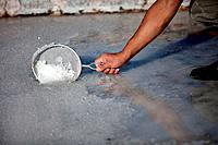 A worker collects flower of salt using a strainer at the Salinas de Hortales salt mine in Prado del Rey, Cadiz, Andalusia, Spain, July 16, 2013. Built...