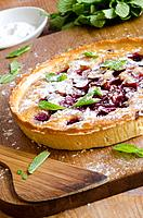 Sour cherry and almond frangipane in pastry decorated with flaked almonds.