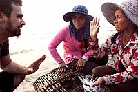 Women sell crabs at the crab market in the resort town of Kep, Cambodia.