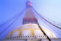 NEPAL, KATHMANDU, BOUDHNATH, TIBETAN STUPA (TEMPLE) IN FOG, PRAYER FLAGS.