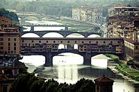 Ponte Vecchio, Florence with reflections in the Arno River.
