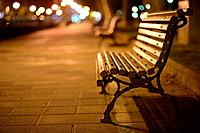 Lonely wooden bench in Bilbao at night, Biscay, Basque Country, Spain, Europe