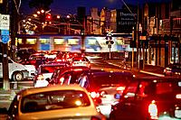 Traffic congestion car wait at railway crossing, evening peak hour, Melbourne Australia