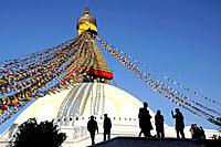 Silhouettes in front of the Bodnath stupa in Kathmandu. Nepal, Kathmandu, Bodnath.