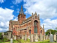 Kirkwall, the capital of the Orkney Islands, part of the Northern Isles of Scotland.St. Magnus Cathedral in the center of Kirkwall. the cathedral is a...