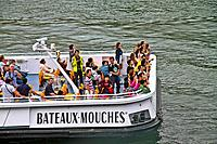 Toursits at Bateaux Mouches, Paris, France.
