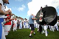 Teazer dances with the Red Oss-Padstow-Obby Oss-Cornwall-UK.
