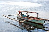 Traditional Outrigger Boat in Manila Bay, Philippines.