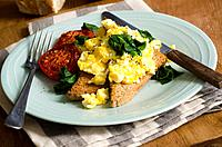 Eggs on Rye with spinach and roasted tomatoes.