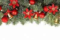 Holiday frame with Christmas tree branches on white background.