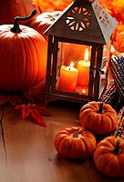 Lanterns with burning candles and pumpkins.