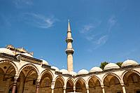 A minaret and arches, Suleymaniye Mosque, from the inner courtyard, Istanbul, Turkey	.