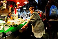 Barcelona, Spain. La Boqueria market. Stallholders talking.