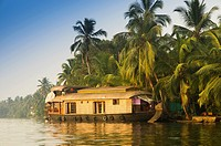 A traditional Kettuvallam on Kerala Backwaters, South India.