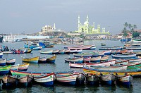 Fishing boats with Vizhinjam mosque in the background, Kerala, South India.