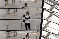 A self-portrait taken in the glass dome of the Reichstag building in Berlin.