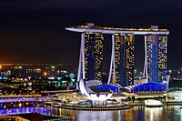 Aerial night view of Marina Bay Sand, a luxury complex that include hotel, casino, exhibition centre and a shopping mall. Singapore.