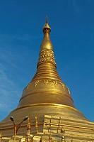 Stupa of the Shwedagon Pagoda in the Twilight in Rangoon, Myanmar.