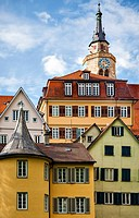 The picturesque architecture of Tübingen, Germany, including Stiftskirche and Hölderlinturm, the yellow tower where Hölderlin lived in utter seclusion...
