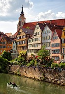 Students and tourists enjoying the weather and picturesque architecture of Tübingen, Germany.