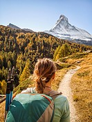 A hiker preparing to hike up the Matterhorn near Zermatt, Switzerland.