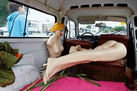 one female mannequin in the back of a car