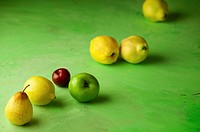 fruit yellow, green and red diagonal green background.