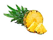 ripe pineapple with slices isolated on white.