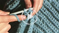 Slow motion of women doing crochet with blue wool thread, Andalusia, Spain