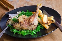 Roast duck leg with steamed curly kale and roast parsnips.