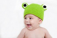 Baby girl in frog hat.