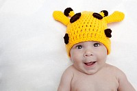 Baby girl in giraffe hat.